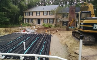 Bonica Excavation, Inc. Installing a septic system at a customers property.